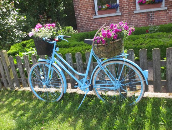 Blue bike sculpture plant holder